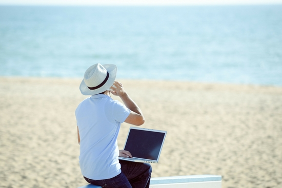 Man using phone on beach