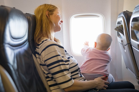 Baby and mother on a plane