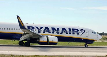 Ryanair cuts its airport check-in fee